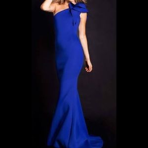 Jovani blue bow accented asymmetrical mermaid gown